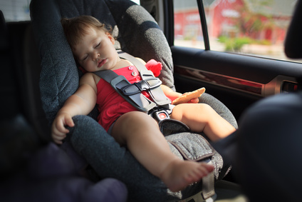 Toddler girl sleeping in child car seat.